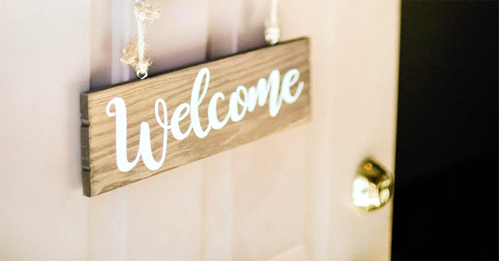 opening door with welcome sign